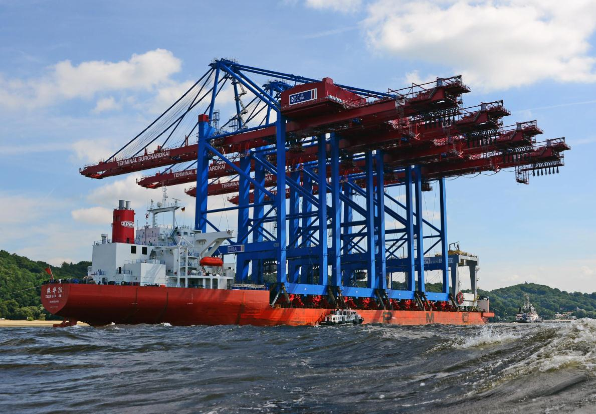 Gantry cranes transportation by a sea-going barge